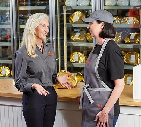 HoneyBaked Ham - Franchisee talking to employee
